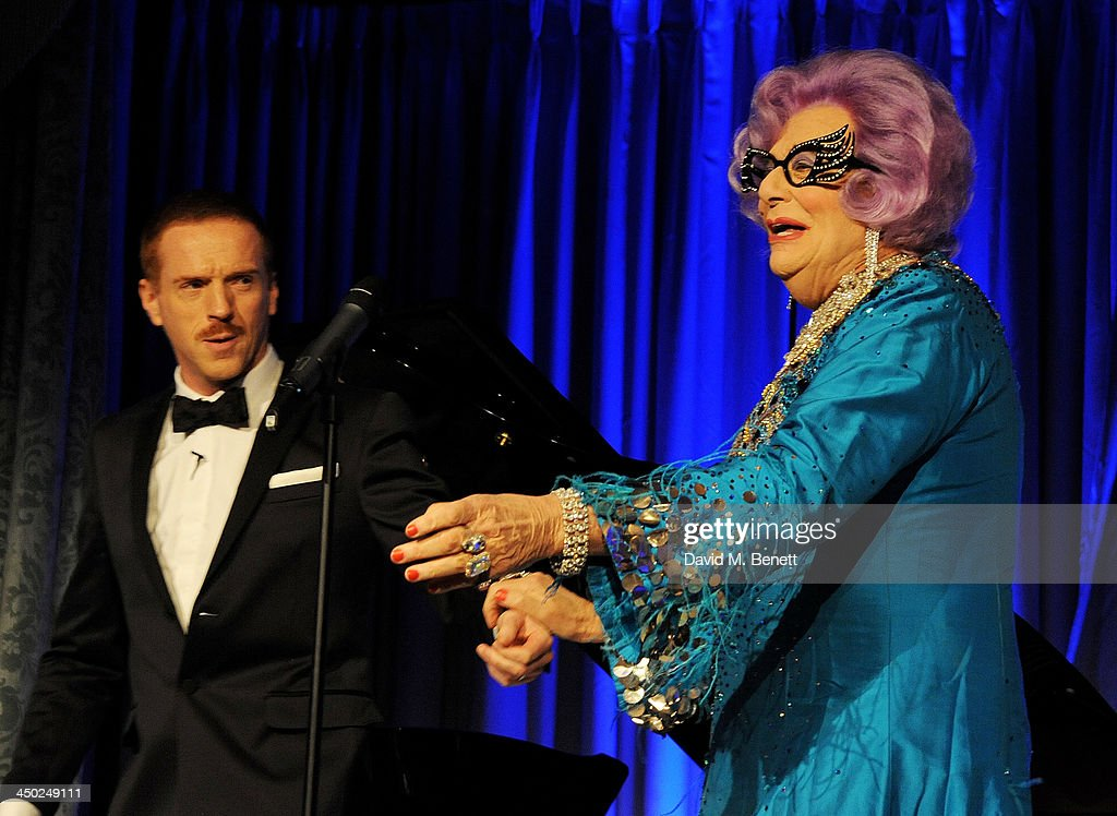 Damian Lewis (L) and Dame Edna Everage speak the 59th London Evening Standard Theatre Awards at The Savoy Hotel on November 17, 2013 in London, England.