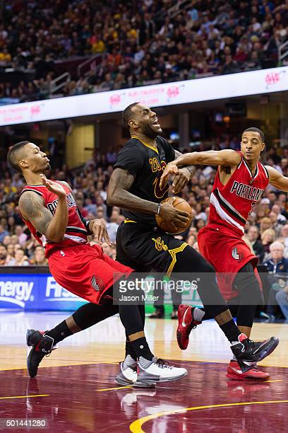 Damian Lillard and CJ McCollum of the Portland Trail Blazers guard LeBron James of the Cleveland Cavaliers during the second half at Quicken Loans...