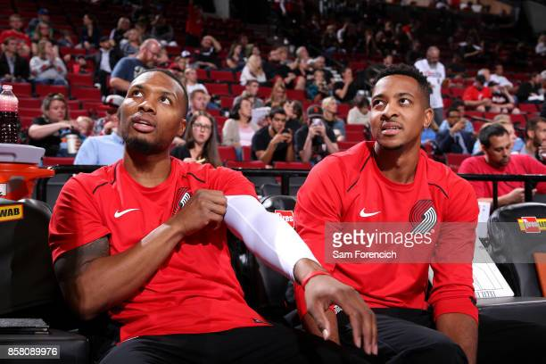 Damian Lillard and CJ McCollum of the Portland Trail Blazers look on during the game against the Toronto Raptors during a preseason game on October 5...