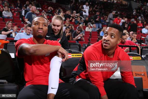 Damian Lillard and CJ McCollum of the Portland Trail Blazers look on during a pre season game against the Toronto Raptors on October 5 2017 at the...