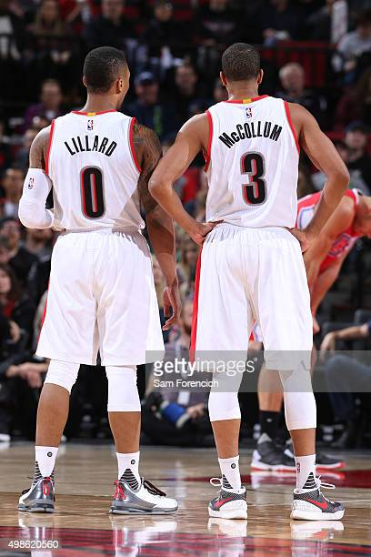 Damian Lillard and CJ McCollum of the Portland Trail Blazers stand on the court during the game against the Los Angeles Clippers on November 20 2015...