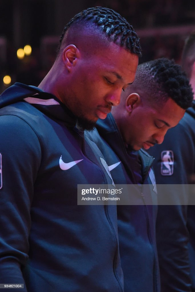 Damian Lillard #0 and CJ McCollum #3 of the Portland Trail Blazers stand for the National Anthem before the game against the LA Clippers on March 18, 2018 at STAPLES Center in Los Angeles, California.
