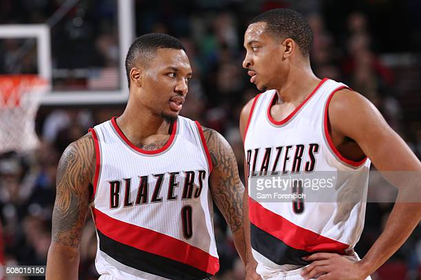 Damian Lillard and CJ McCollum of the Portland Trail Blazers talks during the game against the Minnesota Timberwolves on January 31 2016 at the Moda...