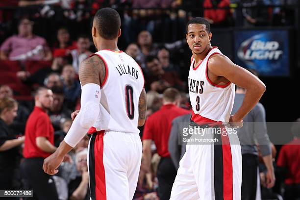 Damian Lillard and CJ McCollum of the Portland Trail Blazers walk off the court against the Dallas Mavericks on December 1 2015 at the Moda Center...