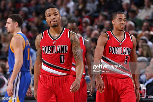 Damian Lillard and CJ McCollum of the Portland Trail Blazers walk off the court against the Golden State Warriors on January 8 2016 at the Moda...