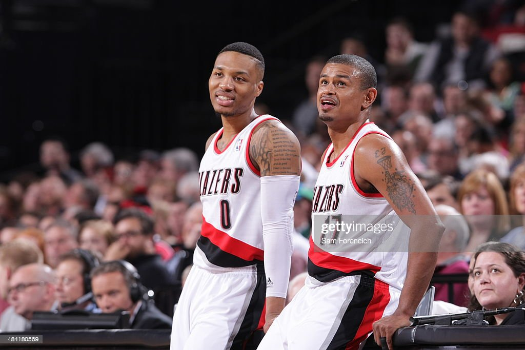 <a gi-track='captionPersonalityLinkClicked' href=/galleries/search?phrase=Damian+Lillard&family=editorial&specificpeople=6598327 ng-click='$event.stopPropagation()'>Damian Lillard</a> #0 and <a gi-track='captionPersonalityLinkClicked' href=/galleries/search?phrase=Earl+Watson&family=editorial&specificpeople=201841 ng-click='$event.stopPropagation()'>Earl Watson</a> #17 of the Portland Trail Blazers smile while they wait to get into the game against the Sacramento Kings on April 9, 2014 at the Moda Center Arena in Portland, Oregon.