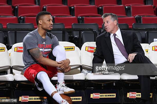 Damian Lillard and General Manager Neil Olshey of the Portland Trail Blazers talk before the game against the Sacramento Kings on March 28 2016 at...