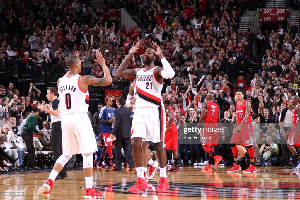 Damian Lillard #0 and J.J. Hickson #21 of the Portland Trailblazers give eachother a high five against the Los Angeles Clippers in a game on January 26, 2013 at the Rose Garden Arena in Portland, Oregon.