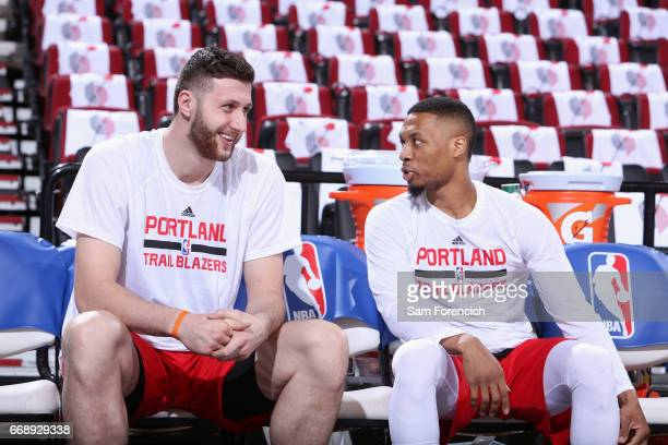 Damian Lillard and Jusef Nurkic of the Portland Trailblazers talk before the game against the Minnesota Timberwolves on April 6 2017 at the Moda...