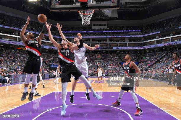 Damian Lillard and Jusuf Nurkic of the Portland Trail Blazers rebound against the Sacramento Kings on October 9 2017 at Golden 1 Center in Sacramento...