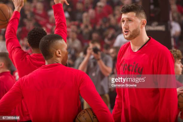 Damian Lillard and Jusuf Nurkic of the Portland Trail Blazers talk before Game Three of the Western Conference Quarterfinals against the Golden State...