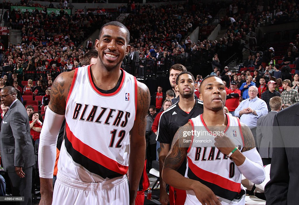 <a gi-track='captionPersonalityLinkClicked' href=/galleries/search?phrase=Damian+Lillard&family=editorial&specificpeople=6598327 ng-click='$event.stopPropagation()'>Damian Lillard</a> #0 and <a gi-track='captionPersonalityLinkClicked' href=/galleries/search?phrase=LaMarcus+Aldridge&family=editorial&specificpeople=453277 ng-click='$event.stopPropagation()'>LaMarcus Aldridge</a> #12 of the Portland Trail Blazers smile after the game against the New Orleans Pelicans on December 21, 2013 at the Moda Center Arena in Portland, Oregon.