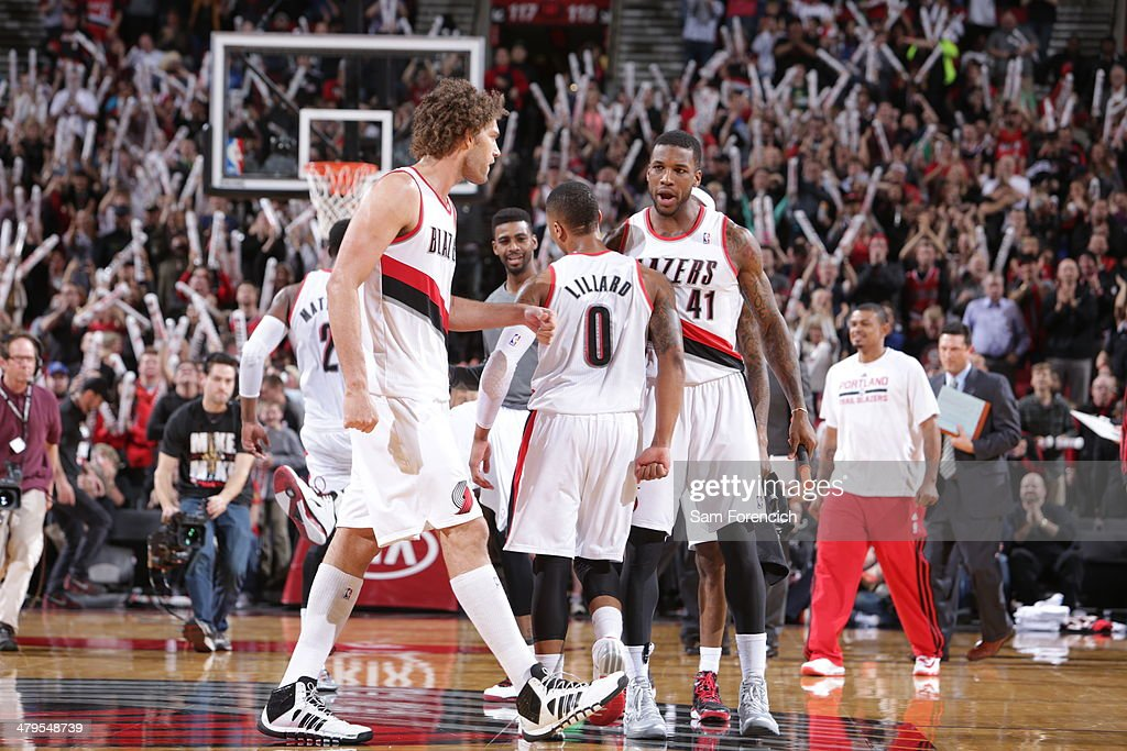 Damian Lillard #0 and the Portland Trail Blazers celebrate against the Milwaukee Bucks on March 18, 2014 at the Moda Center Arena in Portland, Oregon.