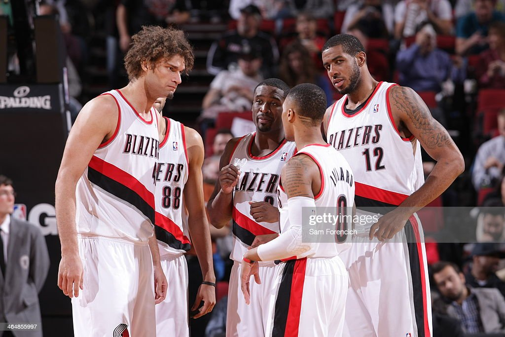 <a gi-track='captionPersonalityLinkClicked' href=/galleries/search?phrase=Damian+Lillard&family=editorial&specificpeople=6598327 ng-click='$event.stopPropagation()'>Damian Lillard</a> #0 and the Portland Trail Blazers huddle up during the game against the Denver Nuggets on January 23, 2014 at the Moda Center Arena in Portland, Oregon.