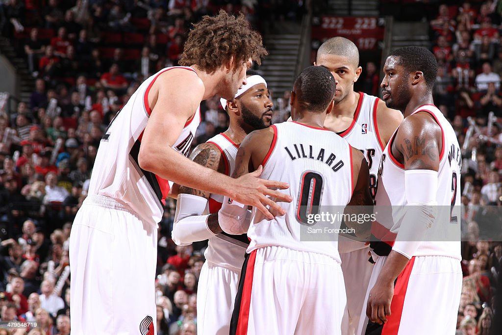 Damian Lillard #0 and the Portland Trail Blazers huddle up during the game against the Milwaukee Bucks on March 18, 2014 at the Moda Center Arena in Portland, Oregon.
