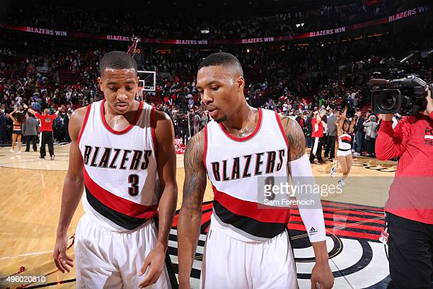 Damian Lillard chats with CJ McCollum of the Portland Trail Blazers after the game against the New Orleans Pelicans on October 28 2015 at the Moda...