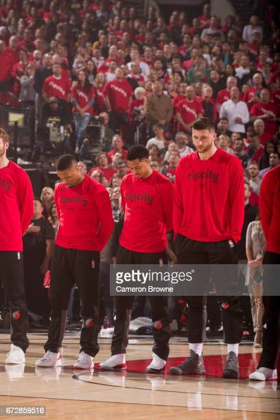 Damian Lillard CJ McCollum and Jusuf Nurkic of the Portland Trail Blazers stand on the court before Game Three of the Western Conference...