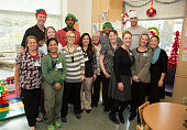 Damian Lillard Head Coach Terry Stotts Will Barton and Victor Claver the Portland Trail Blazers celebrate the holidays with patients and families...
