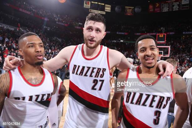 Damian Lillard Jusuf Nurkic and CJ McCollum of the Portland Trail Blazers celebrate a win against the Philadelphia 76ers on March 9 2017 at the Moda...