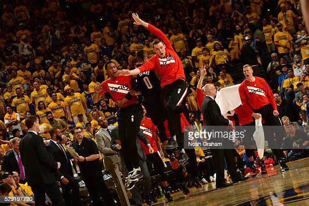 Damian Lillard Luis Montero and Pat Connaughton of the Portland Trail Blazers cheer during the game against the Golden State Warriors in Game Two of...