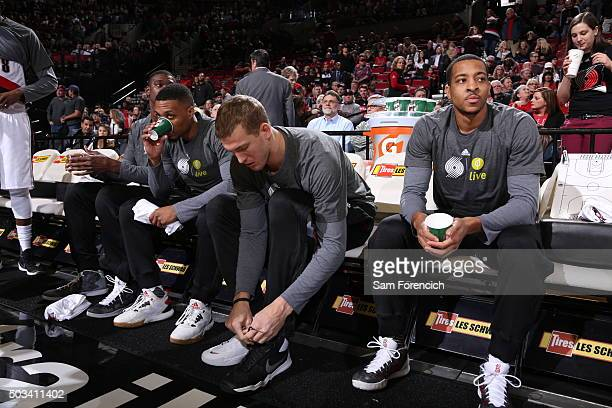 Damian Lillard Mason Plumlee and CJ McCollum of the Portland Trail Blazers warm up before the game against the Memphis Grizzlies on January 4 2016 at...