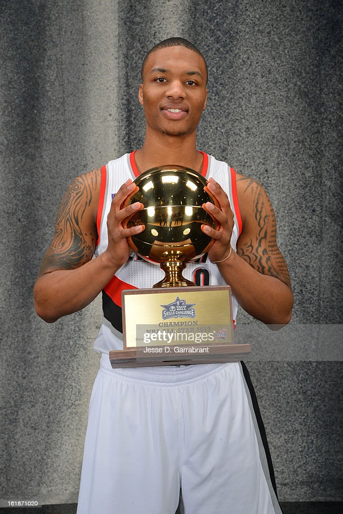 <a gi-track='captionPersonalityLinkClicked' href=/galleries/search?phrase=Damian+Lillard&family=editorial&specificpeople=6598327 ng-click='$event.stopPropagation()'>Damian Lillard</a> of the Portland Blazers poses for a portrait with the 2013 Taco Bell Skills Challenge Trophy on State Farm All-Star Saturday Night as part of 2013 NBA All-Star Weekend on February 16, 2013 at the Toyota Center in Houston, Texas.