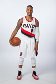 Damian Lillard of the Portland Trail Blazer poses for photos during the teams annual Media Day September 29 2014 at the Veterans Memorial Coliseum in...