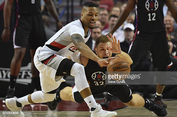 Damian Lillard of the Portland Trail Blazers and Blake Griffin of the Los Angeles Clippers go after a loose ball in the first quarter of Game Four of...