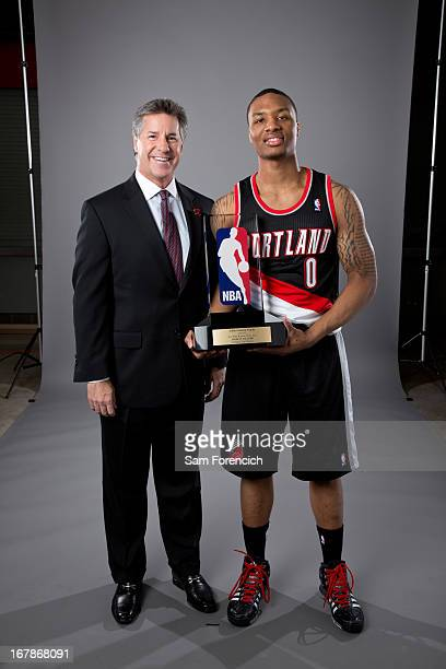 Damian Lillard of the Portland Trail Blazers and Neil Olshey the team's general manager pose with the Eddie Gottlieb Trophy after Lillard won the...