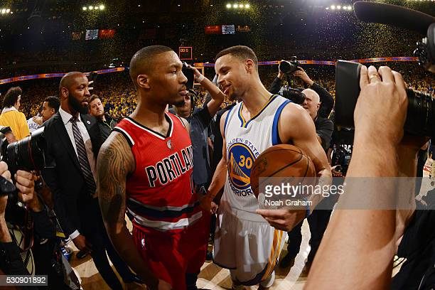 Damian Lillard of the Portland Trail Blazers and Stephen Curry of the Golden State Warriors are seen after the game against the Portland Trail...