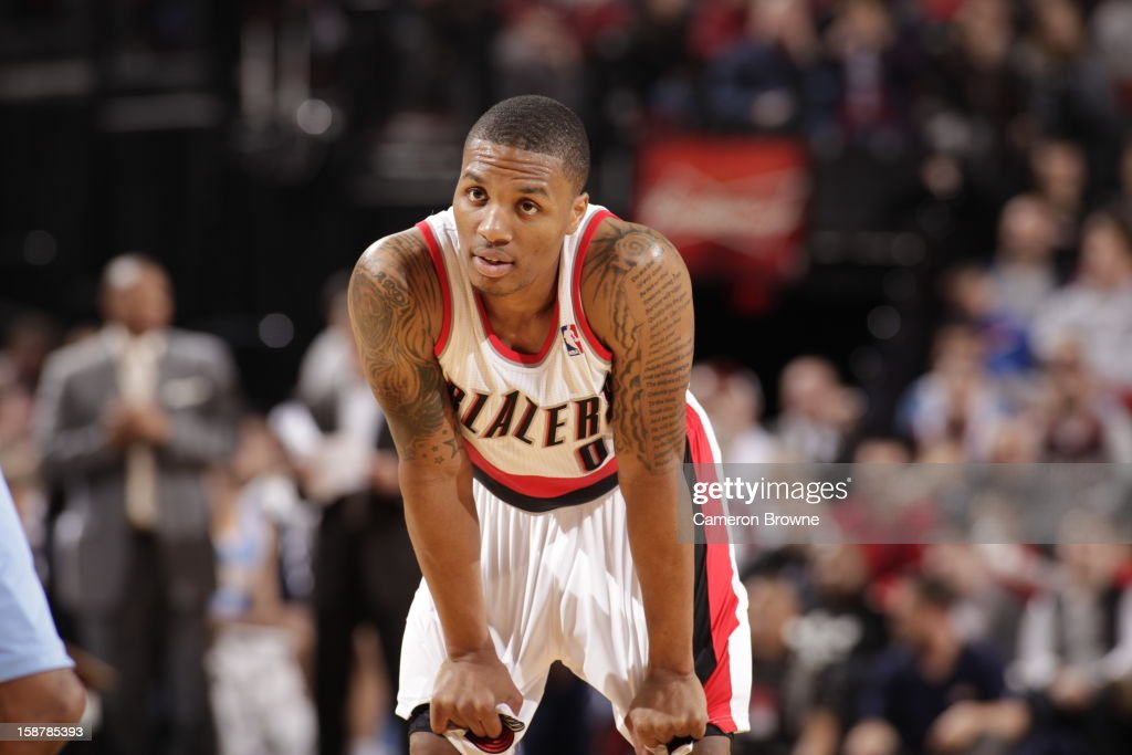 <a gi-track='captionPersonalityLinkClicked' href=/galleries/search?phrase=Damian+Lillard&family=editorial&specificpeople=6598327 ng-click='$event.stopPropagation()'>Damian Lillard</a> #0 of the Portland Trail Blazers awaits a foul shot during the game against the Denver Nuggets on December 20, 2012 at the Rose Garden Arena in Portland, Oregon.