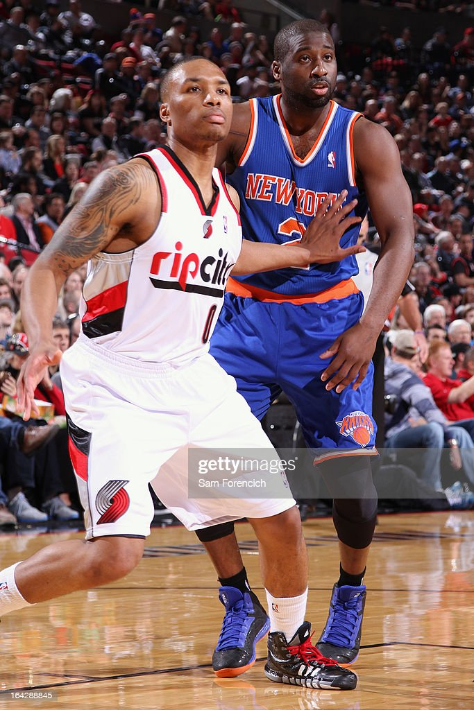 <a gi-track='captionPersonalityLinkClicked' href=/galleries/search?phrase=Damian+Lillard&family=editorial&specificpeople=6598327 ng-click='$event.stopPropagation()'>Damian Lillard</a> #0 of the Portland Trail Blazers boxes out <a gi-track='captionPersonalityLinkClicked' href=/galleries/search?phrase=Raymond+Felton&family=editorial&specificpeople=209141 ng-click='$event.stopPropagation()'>Raymond Felton</a> #2 of the New York Knicks on March 14, 2013 at the Rose Garden Arena in Portland, Oregon.