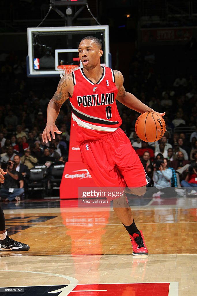 <a gi-track='captionPersonalityLinkClicked' href=/galleries/search?phrase=Damian+Lillard&family=editorial&specificpeople=6598327 ng-click='$event.stopPropagation()'>Damian Lillard</a> #0 of the Portland Trail Blazers brings the ball up court against the Washington Wizards at the Verizon Center on November 28, 2012 in Washington, DC.