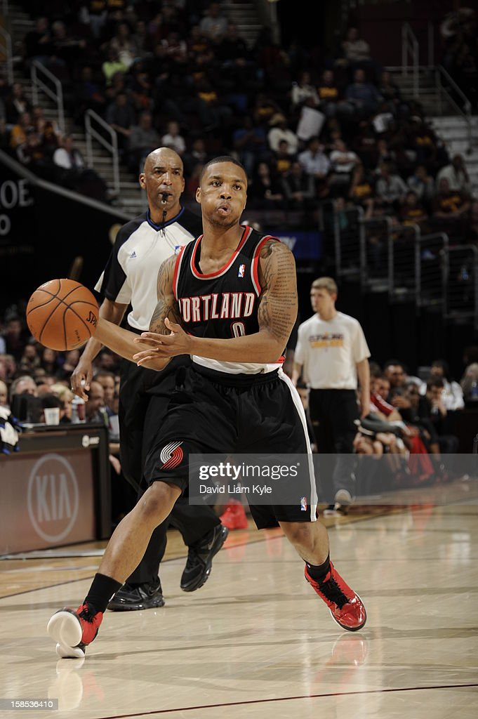 <a gi-track='captionPersonalityLinkClicked' href=/galleries/search?phrase=Damian+Lillard&family=editorial&specificpeople=6598327 ng-click='$event.stopPropagation()'>Damian Lillard</a> #0 of the Portland Trail Blazers brings the ball up court against the Cleveland Cavaliers at The Quicken Loans Arena on December 1, 2012 in Cleveland, Ohio.