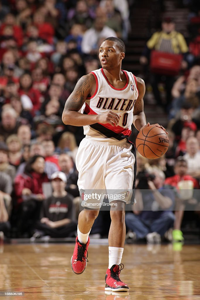<a gi-track='captionPersonalityLinkClicked' href=/galleries/search?phrase=Damian+Lillard&family=editorial&specificpeople=6598327 ng-click='$event.stopPropagation()'>Damian Lillard</a> #0 of the Portland Trail Blazers brings the ball up court during the game between the Philadelphia 76ers and the Portland Trail Blazers on December 29, 2012 at the Rose Garden Arena in Portland, Oregon.
