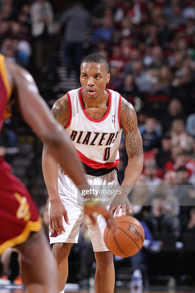 <a gi-track='captionPersonalityLinkClicked' href=/galleries/search?phrase=Damian+Lillard&family=editorial&specificpeople=6598327 ng-click='$event.stopPropagation()'>Damian Lillard</a> #0 of the Portland Trail Blazers brings the ball up court against the Cleveland Cavaliers on January 16, 2013 at the Rose Garden Arena in Portland, Oregon.