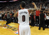 Damian Lillard of the Portland Trail Blazers celebrates after hitting a last second shot to win the game in the fourth quarter of Game Six of the...