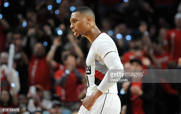 Damian Lillard of the Portland Trail Blazers celebrates after hitting a three point shot late in the fourth quarter of an NBA game against the Utah...