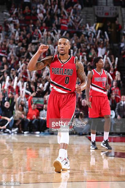 Damian Lillard of the Portland Trail Blazers celebrates against the Oklahoma City Thunder on January 10 2016 at the Moda Center Arena in Portland...
