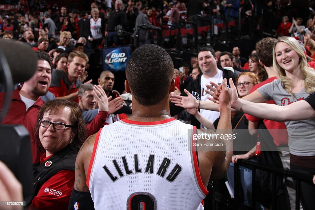 Damian Lillard of the Portland Trail Blazers celebrates and walks off the court against the Houston Rockets in Game Three of the Western Conference...