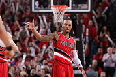 Damian Lillard of the Portland Trail Blazers celebrates during a game against the Phoenix Suns on February 5 2015 at the Moda Center Arena in...