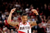 Damian Lillard of the Portland Trail Blazers celebrates during a game against the Houston Rockets in Game Six of the Western Conference Quarterfinals...