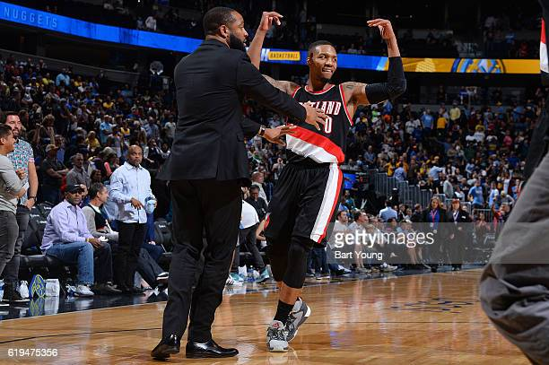 Damian Lillard of the Portland Trail Blazers celebrates during a game against the Denver Nuggets on October 29 2016 at the Pepsi Center in Denver...