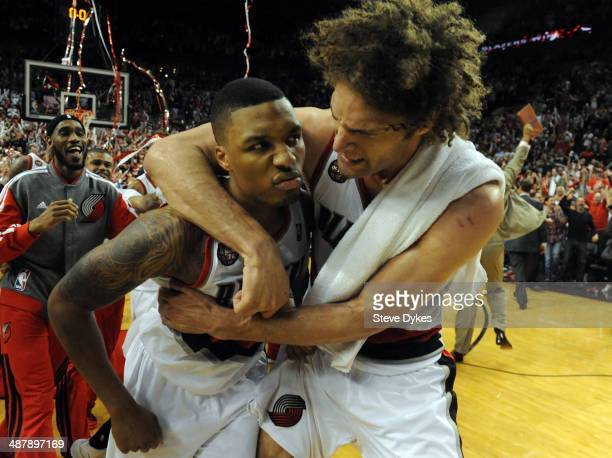 Damian Lillard of the Portland Trail Blazers celebrates with Robin Lopez of the Portland Trail Blazers after Lilliard hit a last second shot to win...