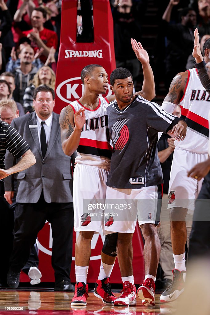 <a gi-track='captionPersonalityLinkClicked' href=/galleries/search?phrase=Damian+Lillard&family=editorial&specificpeople=6598327 ng-click='$event.stopPropagation()'>Damian Lillard</a> #0 of the Portland Trail Blazers celebrates with teammates following their victory against the Phoenix Suns on December 22, 2012 at the Rose Garden Arena in Portland, Oregon.