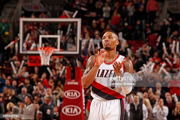 Damian Lillard of the Portland Trail Blazers claps his hands and walks up court during the game against the Indiana Pacers on December 3 2015 at the...