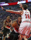 Damian Lillard of the Portland Trail Blazers collides with Pau Gasol of the Chicago Bulls at the United Center on February 27 2016 in Chicago...