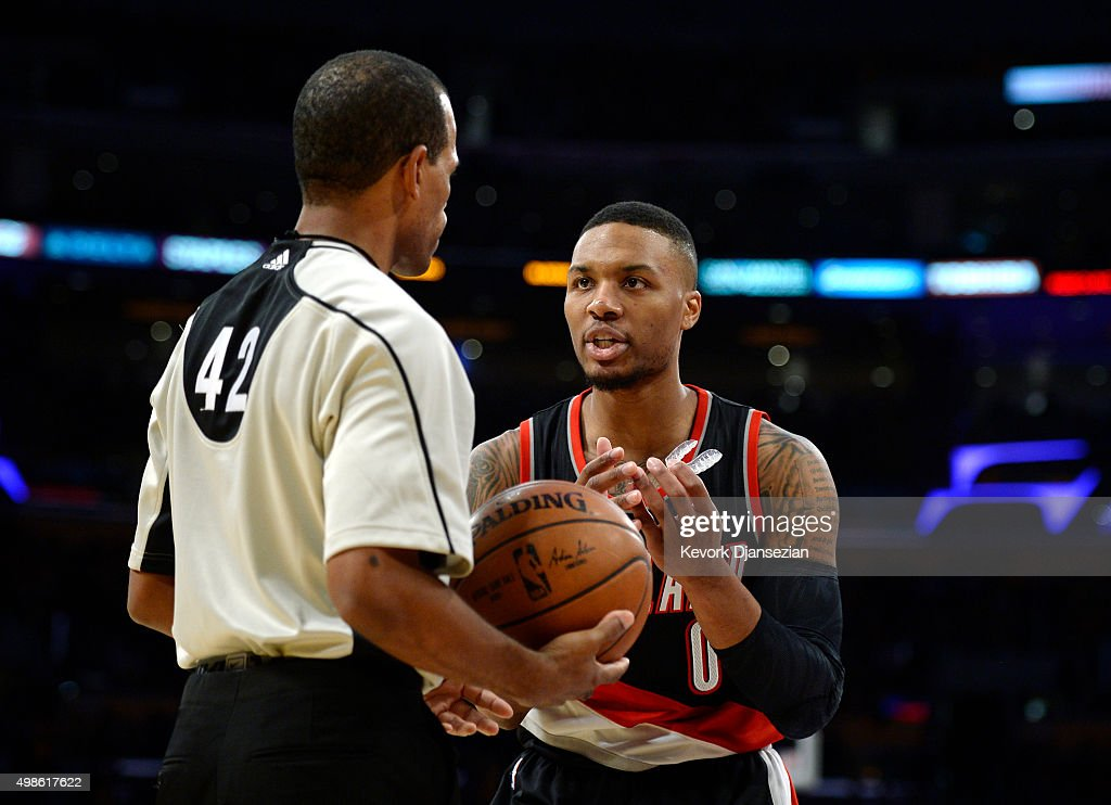 Damian Lillard of the Portland Trail Blazers complains to referee Eric Lewis during the second half of the basketball game against Los Angeles Lakers...