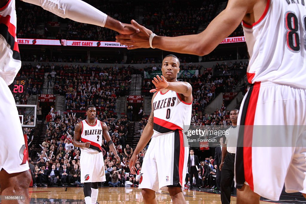 Damian Lillard #0 of the Portland Trail Blazers congradulates teammates on a play during the game against the Dallas Mavericks on January 29, 2013 at the Rose Garden Arena in Portland, Oregon.