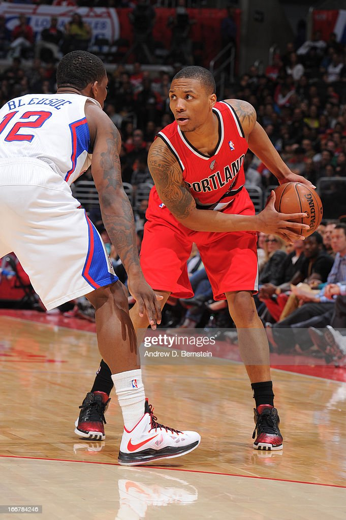 <a gi-track='captionPersonalityLinkClicked' href=/galleries/search?phrase=Damian+Lillard&family=editorial&specificpeople=6598327 ng-click='$event.stopPropagation()'>Damian Lillard</a> #0 of the Portland Trail Blazers controls the ball against <a gi-track='captionPersonalityLinkClicked' href=/galleries/search?phrase=Eric+Bledsoe&family=editorial&specificpeople=6480906 ng-click='$event.stopPropagation()'>Eric Bledsoe</a> #12 of the Los Angeles Clippers during a game at Staples Center on April 16, 2013 in Los Angeles, California.
